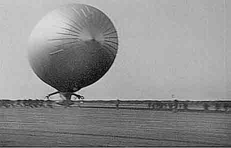 Blimp landing on mat at Lakehurst NAS.